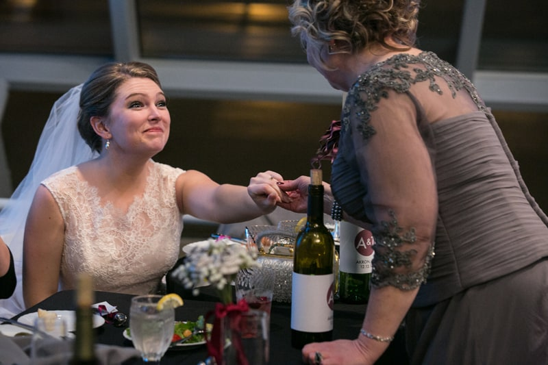 bride with mom at her wedding reception at akron art museum