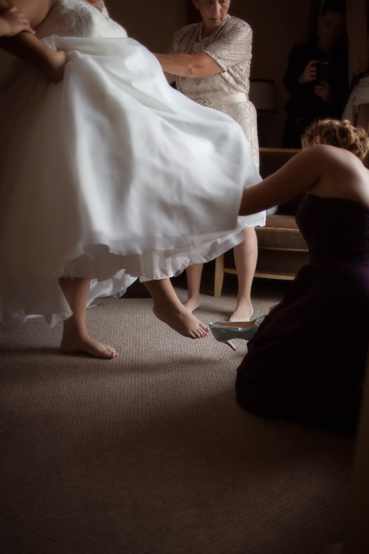 bride putting on her wedding day shoes at hyatt