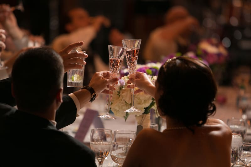 bride and groom toasting at their reception