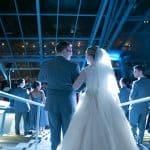 Tim and Alyssa enter their wedding reception at Akron Art Museum