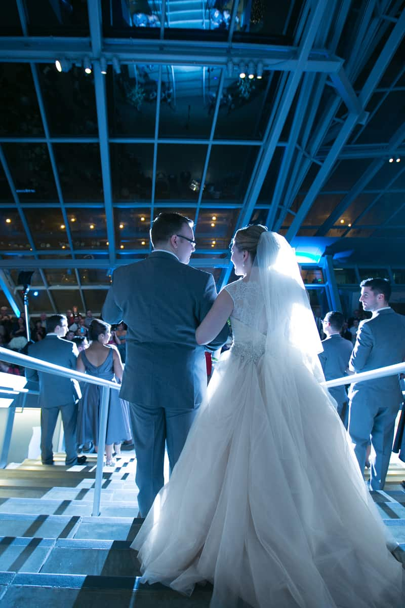 Tim and Alyssa enter their wedding reception at Akron Art Museum