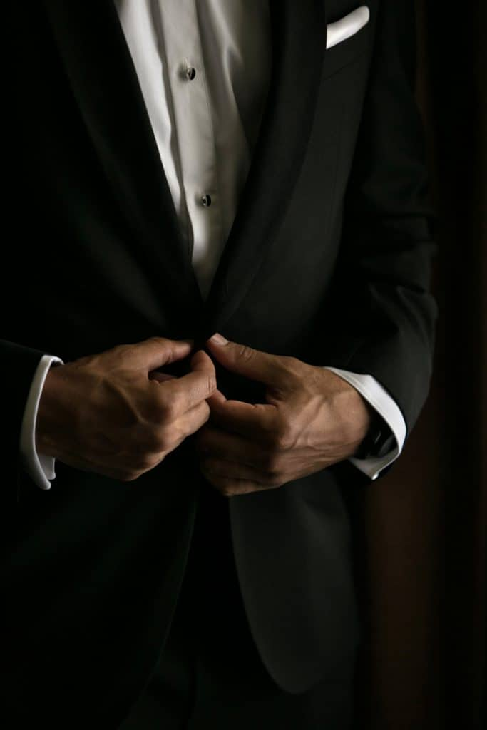 Buttoning up wedding day tux