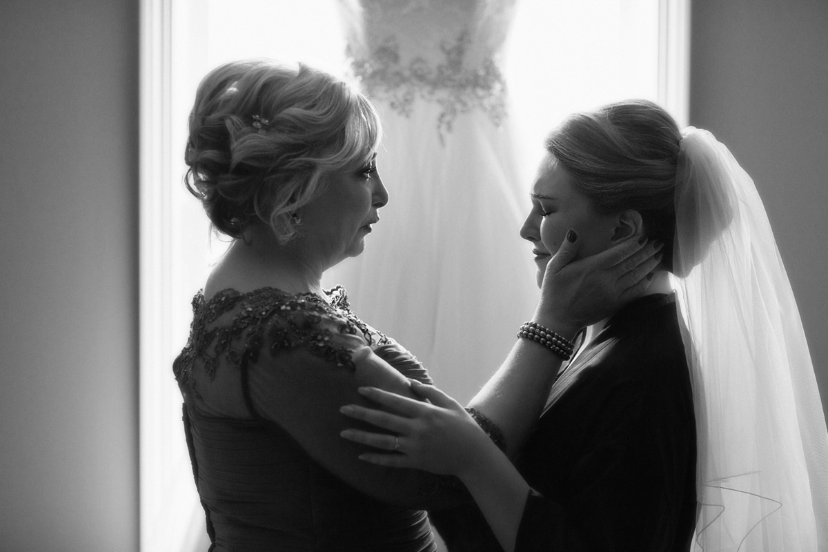 mom consoling bride on her wedding day