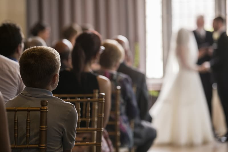 boy watching wedding ceremony
