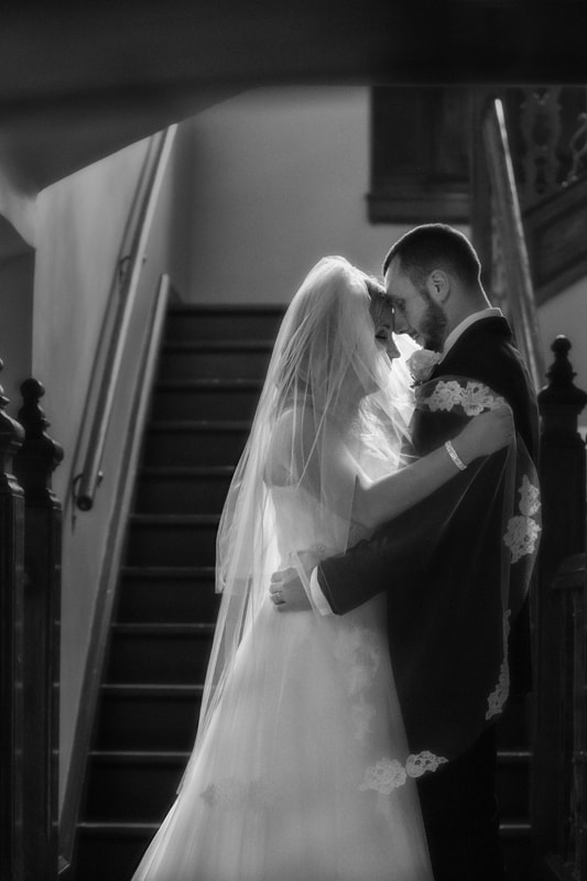 bride and groom picture on staircase