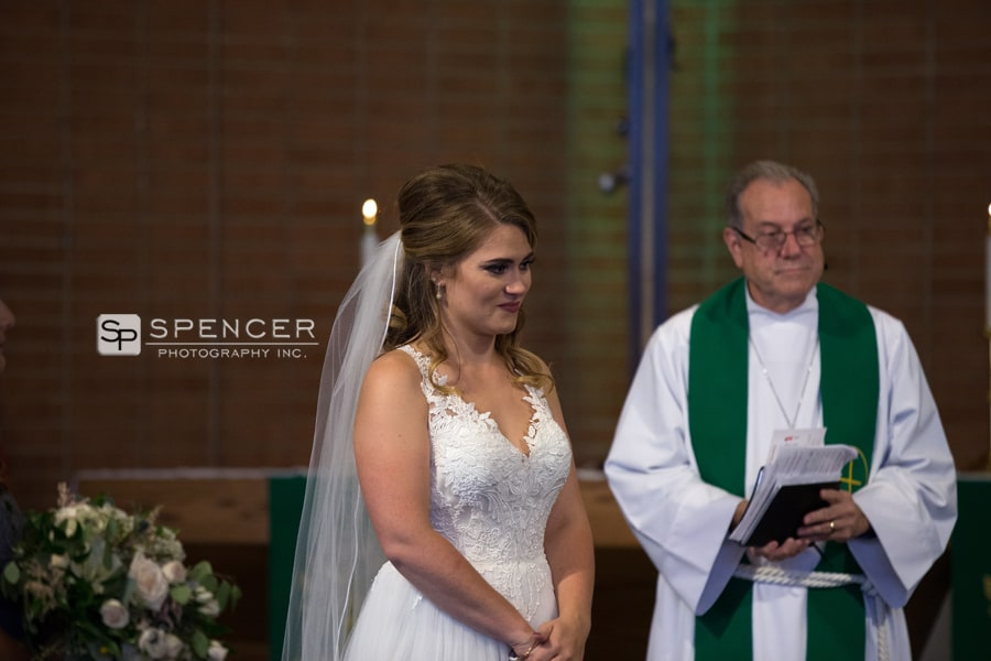 bride watching wedding ceremony speech