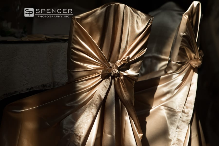 gold chair covers at wedding reception at greystone hall akron