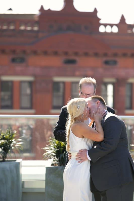 first kiss at wedding at metropolitan
