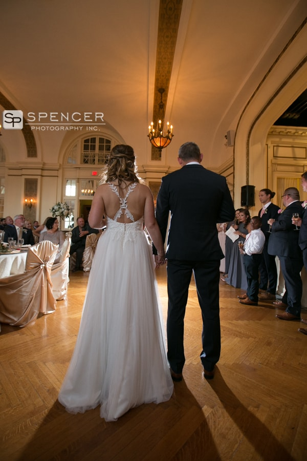 bride and groom holding hands at wedding reception at greystone hall