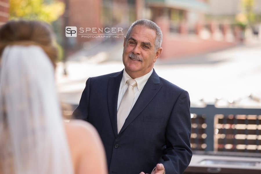 dad seeing daughter in wedding dress on her wedding day