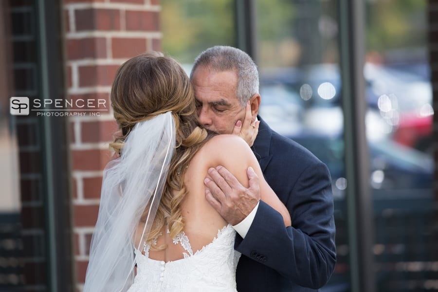 bride hugging dad on her wedding day in akron