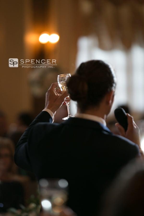 a toast at wedding reception at greystone akron