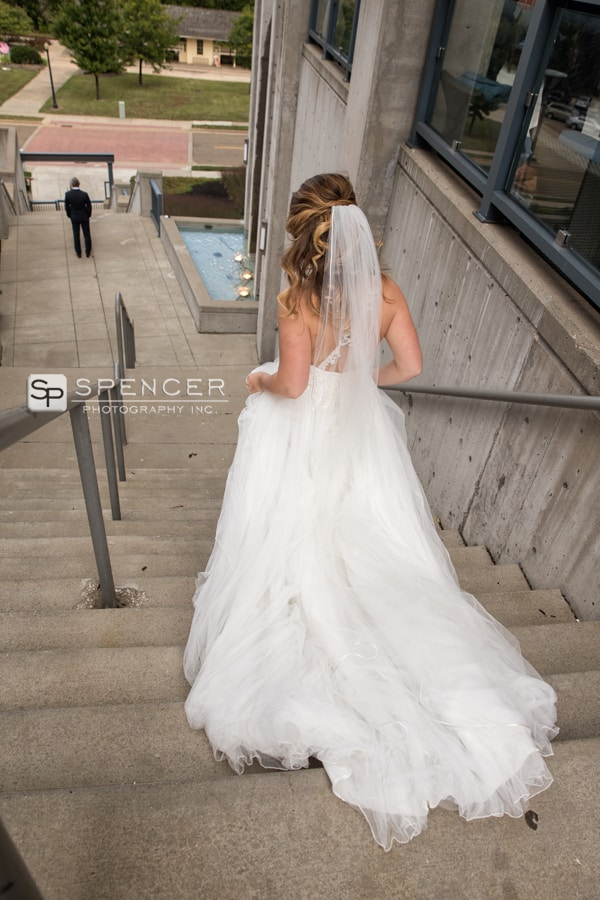 bride walking down stairs to meet groom
