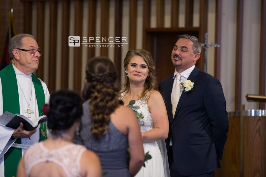 bride smiling at her wedding ceremony