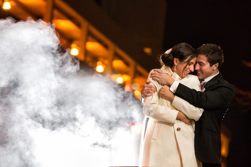 bride and groom hugging in downtown Akron before firestone wedding reception