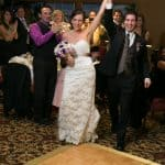 bride and groom enter their wedding reception at firestone