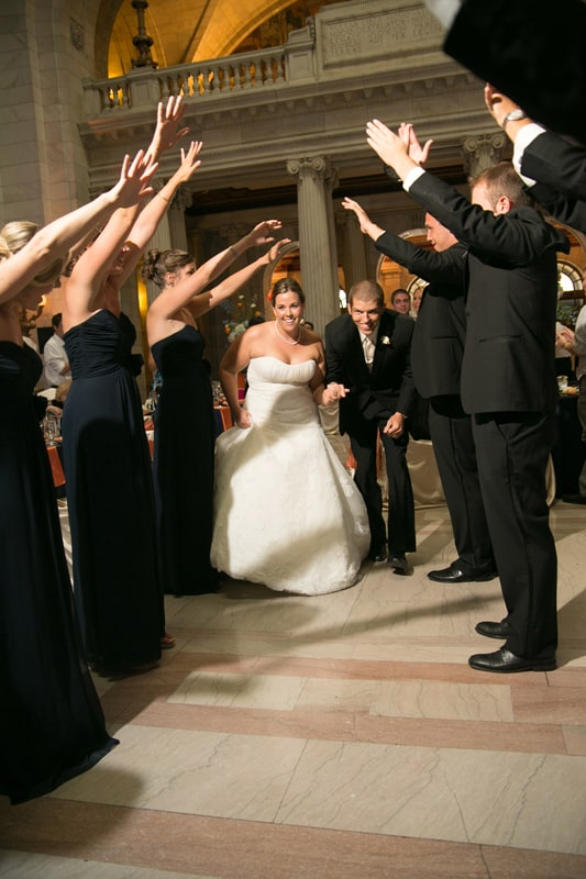 bride and groom enter their wedding reception at cleveland old courthouse