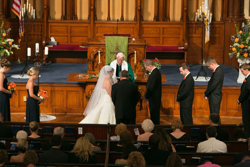 picture of wedding from balcony of old stone church