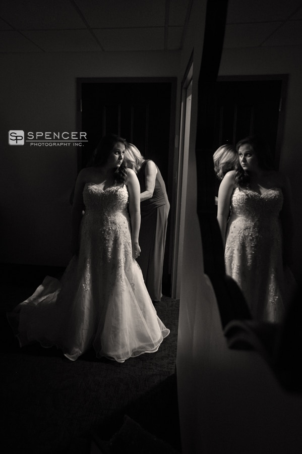 bride putting on wedding dress at music box supper club