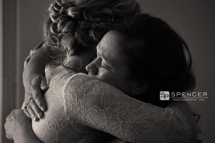 mom crying hugging bride