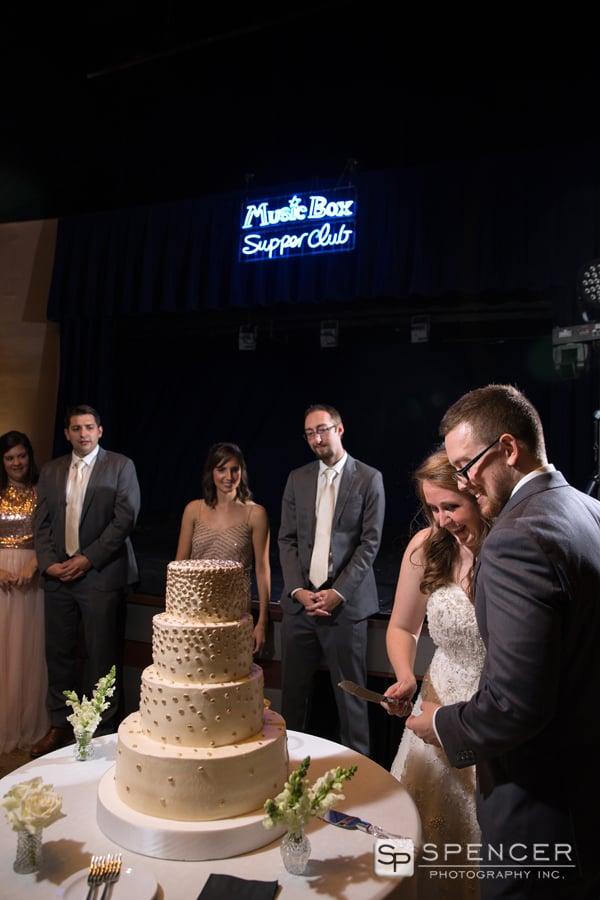 cutting the wedding cake at wedding reception at music box supper club