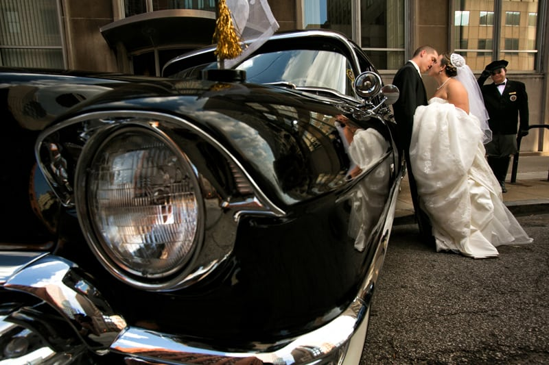 classic car wedding picture at old stone church