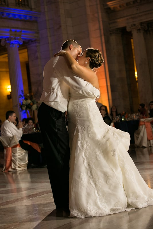 bride and groom kiss at their wedding reception at cleveland old courthouse