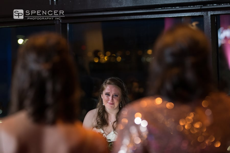 bride reacting to bridesmaid speech