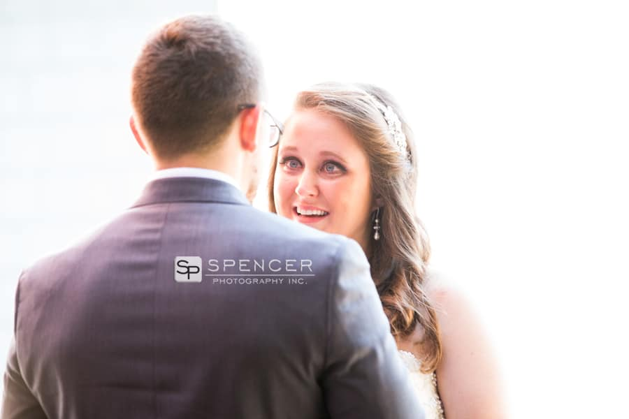 bride smiling at groom on wedding day