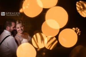 wedding picture thru christmas tree at breitenbach