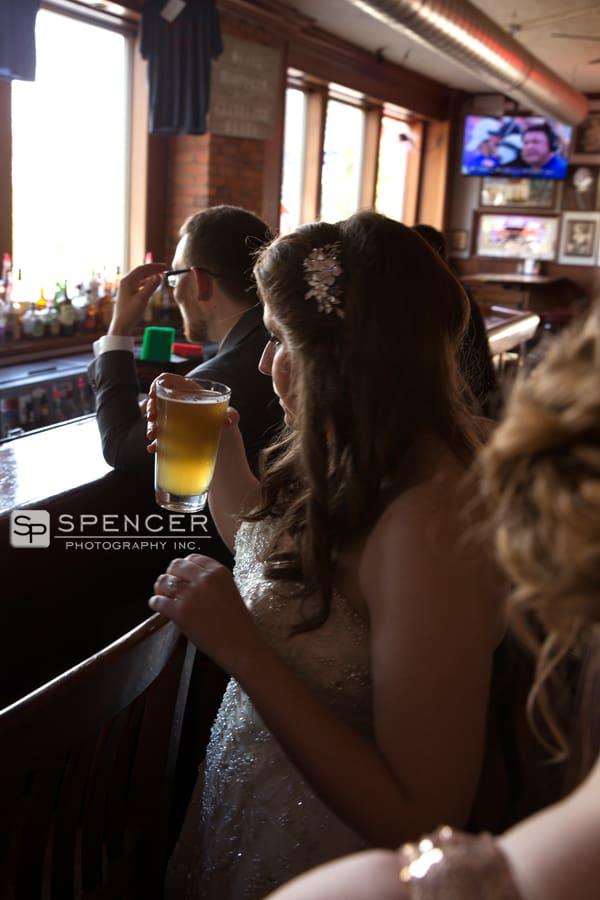bride drinking beer on her wedding day