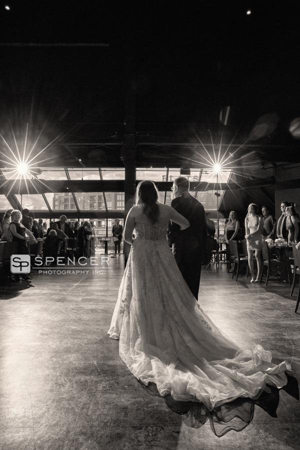 dad walking bride into wedding ceremony at music box supper club