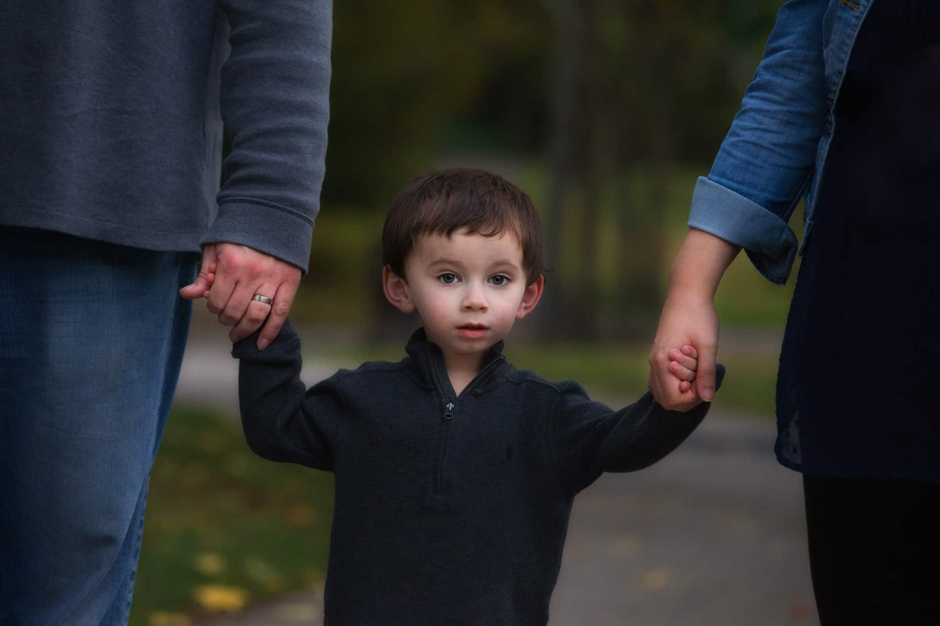 Little boy with parents at Wade Oval Park in Cleveland