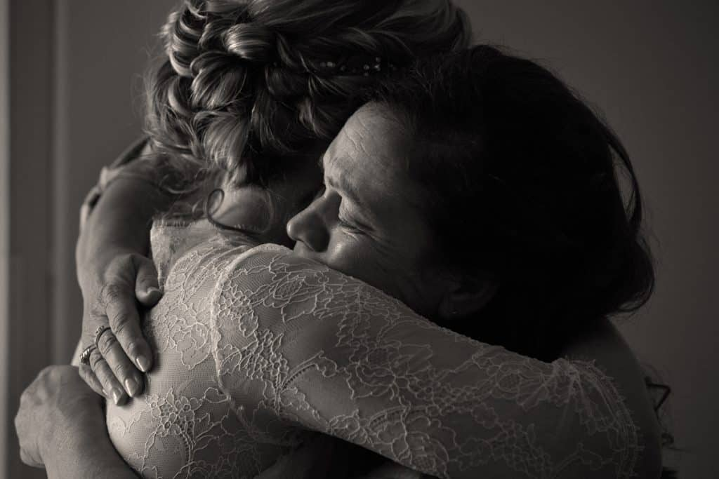 mom crying and hugging bride