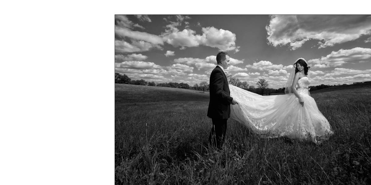 Dramatic wedding picture with clouds and the bride and groom