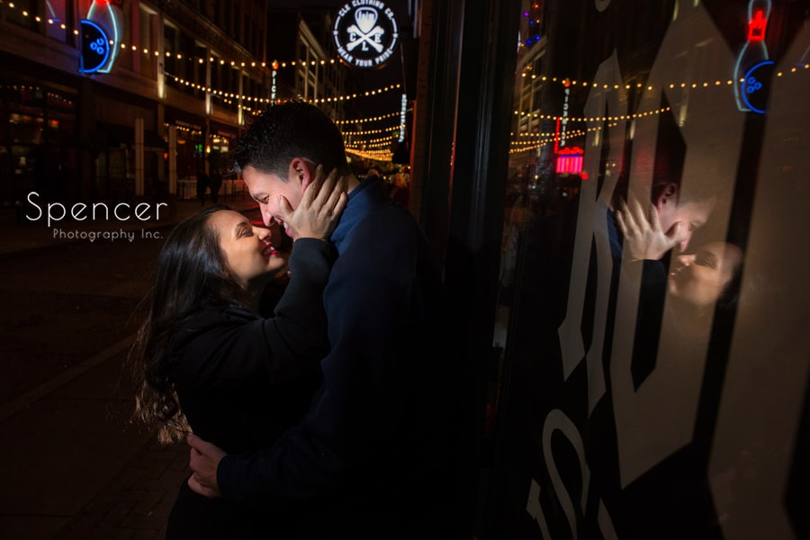 Couple hug during engagement pictures on Cleveland East Fourth Street