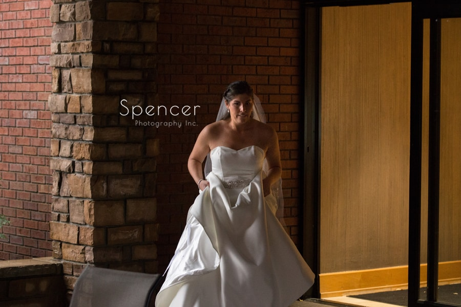 bride walking to her first look with groom