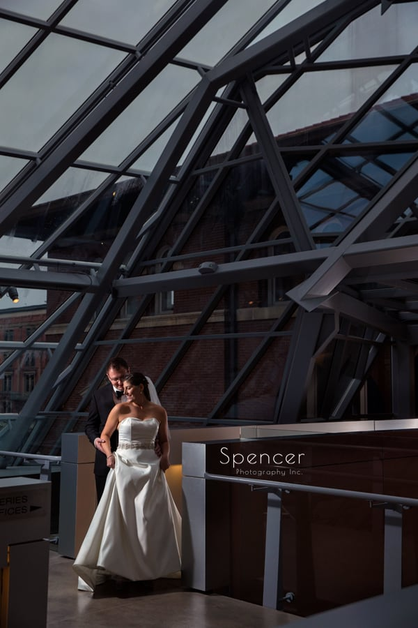 bride and groom on second floor of akron art museum