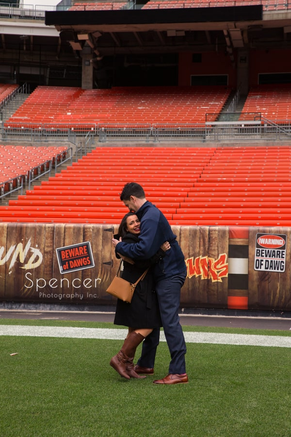 They hug after she accepts his marriage proposal