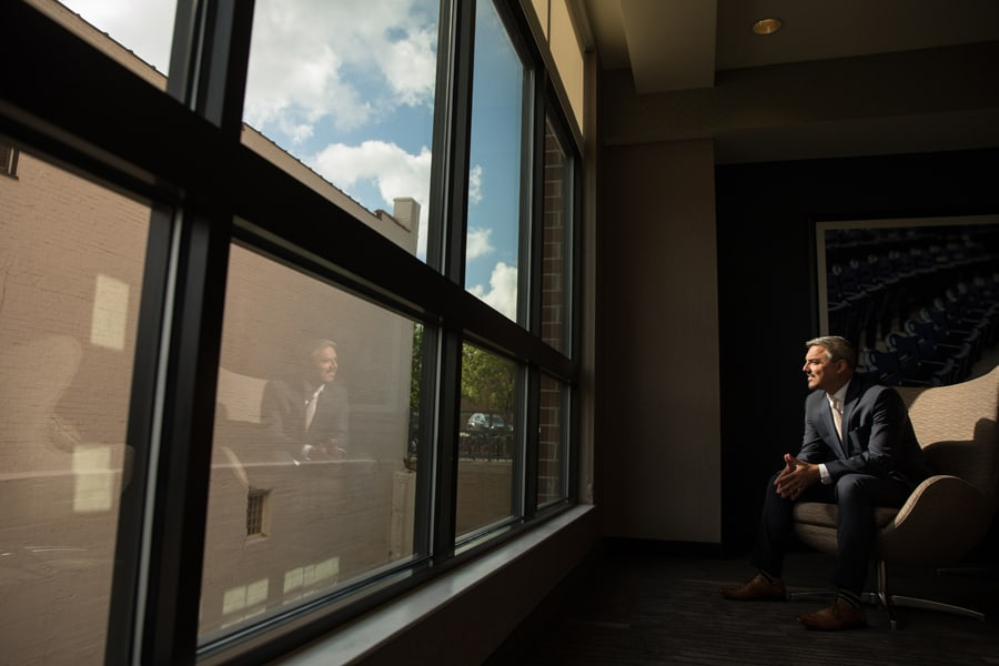 A picture of the groom reflecting in a window