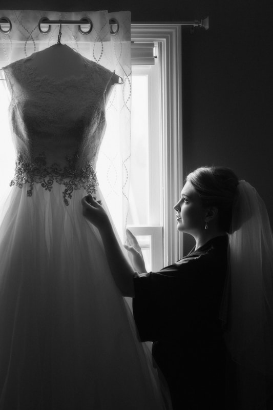 Bride preparing her wedding dress