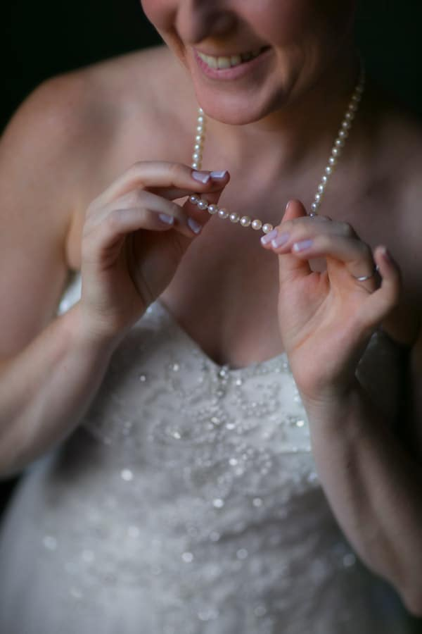 Bride showing off her pearl necklace
