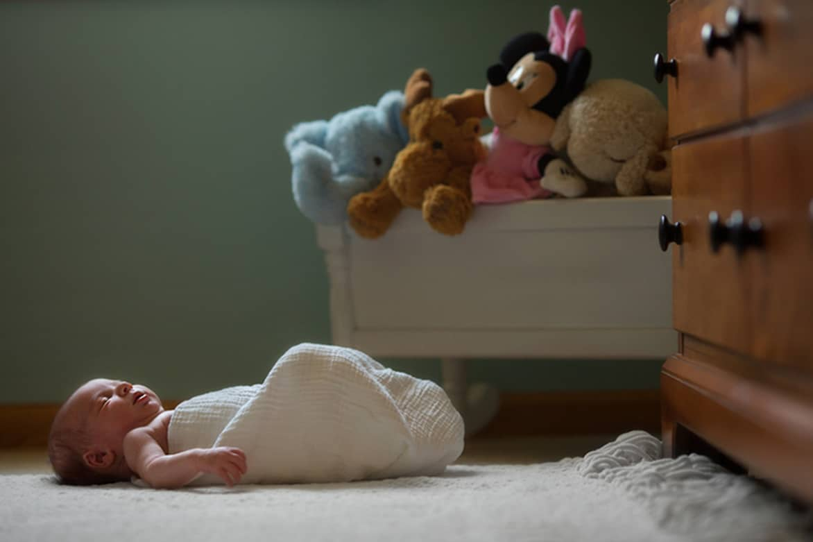 newborn baby sleeping in nursery