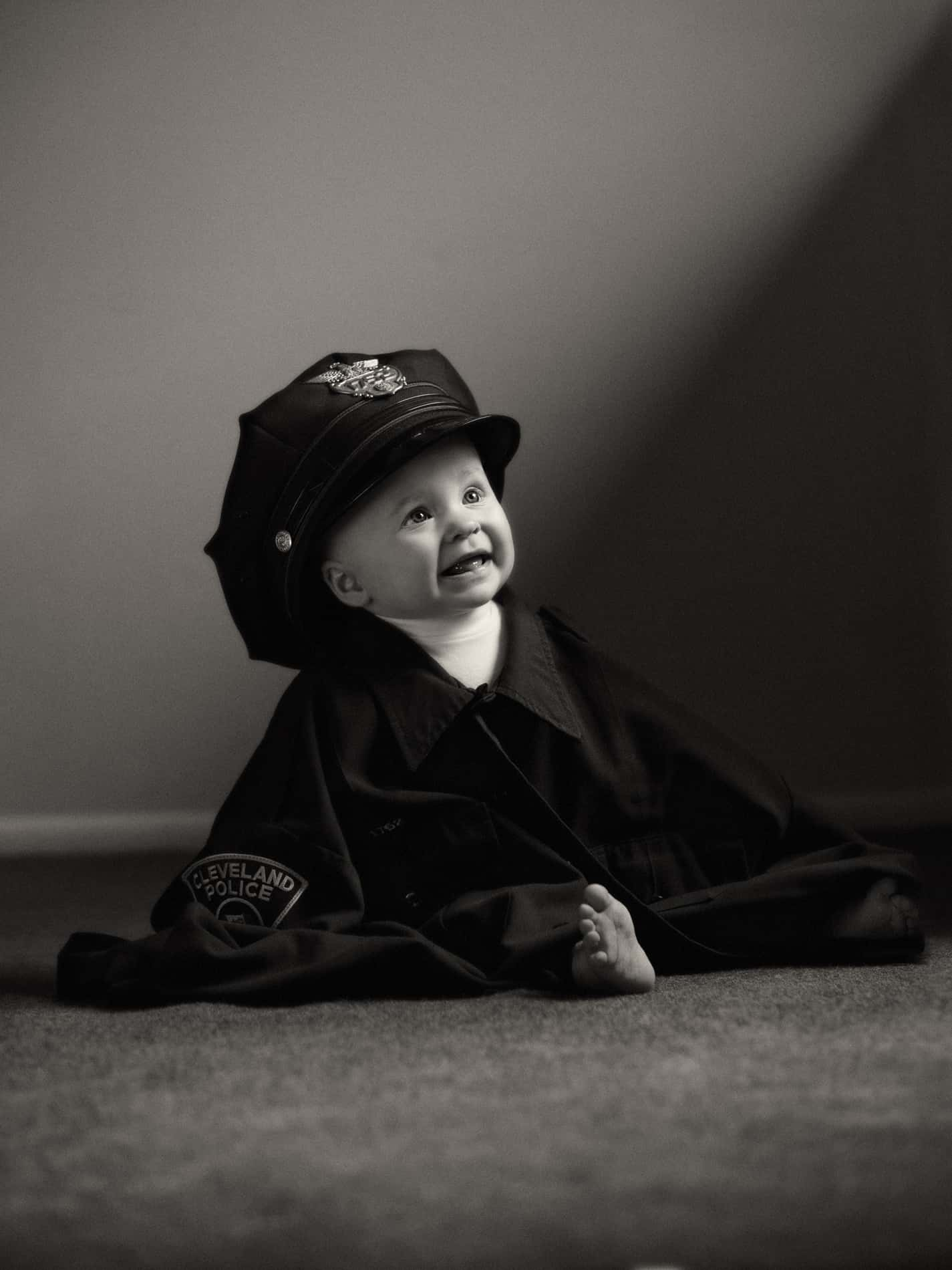 picture of baby in police hat