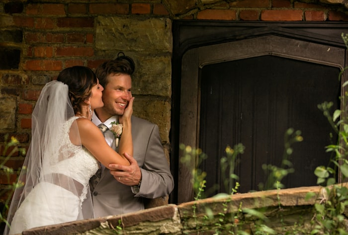 bride and groom at back door of club at hillbrook