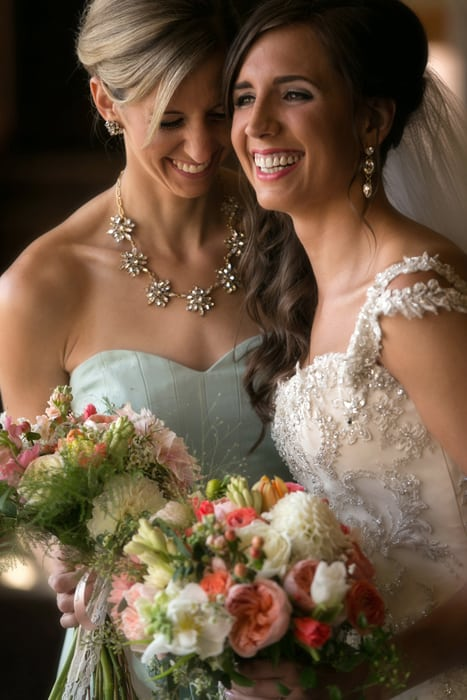 bride laughing with sister