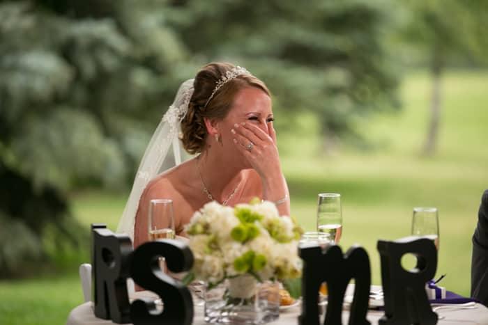 bride laughing at her wedding reception at Gervasi