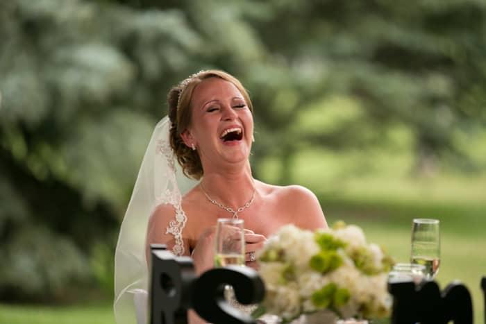 bride cracking up at reception at Gervasi