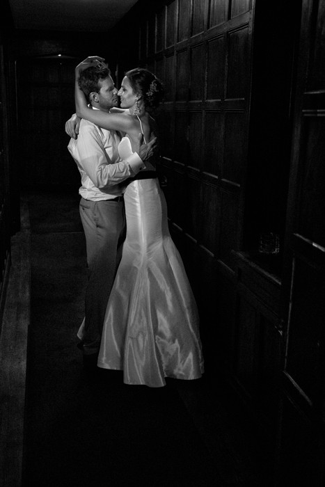 black and white wedding picture of couple in hillbrook hallway