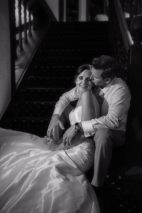 black and white wedding picture on steps of the club at hillbrook